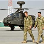 Prince Harry is shown the Apache flight-line by a member of his squadron at Camp Bastion in Helmand Province, Afghanistan where he has been redeployed  125446