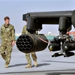 Prince Harry is shown the Apache flight-line by a member of his squadron at Camp Bastion in Helmand Province, Afghanistan where he has been redeployed  125448