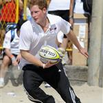 Prince Harry plays rugby with children during a Premiership Rugby training session on Flamengo Beach in Rio De Janeiro, Brazil 108626
