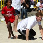 Prince Harry plays rugby with children during a Premiership Rugby training session on Flamengo Beach in Rio De Janeiro, Brazil 108627