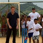 Prince Harry play cricket during a visit to the Favela in Rio De Janeiro, Brazil 108635