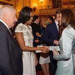 First Lady Michelle Obama and US Ambassador Louis Susman meet Catherine, Duchess of Cambridge during a reception at Buckingham Palace for Heads of State and Government attending the Olympics Opening Ceremony 121844
