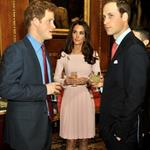 Catherine, Duchess of Cambridge and Prince William speak to Prince Harry during a reception in the Waterloo Chamber, before the Lunch For Sovereign Monarchs at Windsor Castle 114980