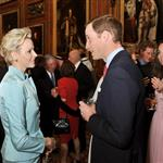 Catherine, Duchess of Cambridge talks to Princess Charlene of Monaco as Prince Albert II of Monaco and Prince William look on during a reception in the Waterloo Chamber, before the Lunch For Sovereign Monarchs at Windsor Castle 114985