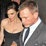 Daniel Craig holds Rachel Weisz's hand as they leave the Four Seasons hotel for the New York premiere of The Bourne Legacy  122032