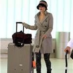 Rachel McAdams arrives at LAX wearing interesting pants  95329