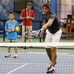 Rafael Nadal participating in a tennis clinic with children from The Child Center of NY 92826