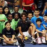 Rafael Nadal participating in a tennis clinic with children from The Child Center of NY 92832
