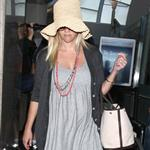 Reese Witherspoon arrives at LAX with her husband Jim Toth 117104