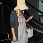 Reese Witherspoon arrives at LAX with her husband Jim Toth 117107