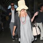 Reese Witherspoon arrives at LAX with her husband Jim Toth 117108
