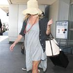 Reese Witherspoon arrives at LAX with her husband Jim Toth 117114