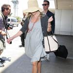 Reese Witherspoon arrives at LAX with her husband Jim Toth 117115