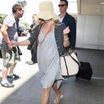 Reese Witherspoon arrives at LAX with her husband Jim Toth 117116