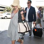 Reese Witherspoon arrives at LAX with her husband Jim Toth 117118