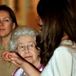 Queen Elizabeth and Catherine tour Royal Wedding exhibit at Buckingham Palace  90635
