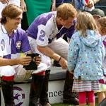 Princes William and Harry at a charity polo match yesterday  122524