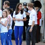 Prince William, Catherine, and Prince Harry welcome the Olympic torch at Buckingham Palace 121782