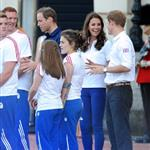 Prince William, Catherine, and Prince Harry welcome the Olympic torch at Buckingham Palace 121784