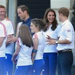 Prince William, Catherine, and Prince Harry welcome the Olympic torch at Buckingham Palace 121790