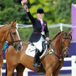 Zara Phillips riding High Kingdom waves to the crowd after receiving a silver medal after the Eventing Team Jumping Final Equestrian event on Day 4 of the London 2012 Olympic Games 122107