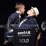 Ryan up on stage at amfAR with Harvey Weinstein and Emily Blunt auctioning off kisses 61761