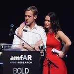 Ryan up on stage at amfAR with Harvey Weinstein and Emily Blunt auctioning off kisses 61763