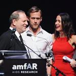 Ryan up on stage at amfAR with Harvey Weinstein and Emily Blunt auctioning off kisses 61764