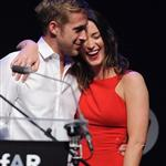 Ryan up on stage at amfAR with Harvey Weinstein and Emily Blunt auctioning off kisses 61765