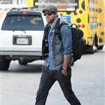 Ryan Reynolds goes for a walk alone at LAX while he waits for his ride 98628
