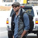 Ryan Reynolds goes for a walk alone at LAX while he waits for his ride 98629
