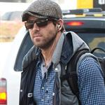 Ryan Reynolds goes for a walk alone at LAX while he waits for his ride 98630