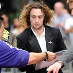 Aaron Taylor-Johnson signs autographs at the London premiere of Anna Karenina 124969