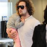 Sam and Aaron Taylor-Johnson arrive in Toronto with their daughters  125239