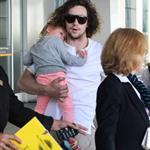 Sam and Aaron Taylor-Johnson arrive in Toronto with their daughters  125241