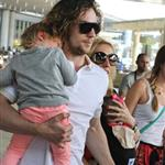 Sam and Aaron Taylor-Johnson arrive in Toronto with their daughters  125243