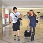 Sam Worthington and stylist Natalie Mark at LAX July 2010  64899