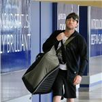 Sam Worthington and stylist Natalie Mark at LAX July 2010  64901