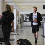 Sam Worthington and stylist Natalie Mark at LAX July 2010  64903