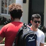 Shia LaBeouf heads to Cafe Med and passes Joe Jonas on the way in West Hollywood 91608