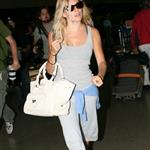 Sienna Miller cannot ignore paparazzi at LAX 23765