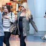 Jessica Simpson looking mega pregnant going through JFK 96962