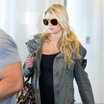 Jessica Simpson looking mega pregnant going through JFK 96965