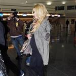 Jessica Simpson looking mega pregnant going through JFK 96967