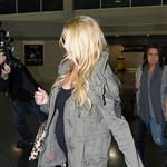 Jessica Simpson looking mega pregnant going through JFK 96968