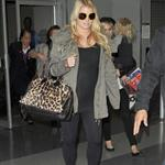 Jessica Simpson looking mega pregnant going through JFK 96969