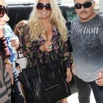 Jessica Simpson and her fiance Eric Johnson walk with their baby through JFK Airport 125841
