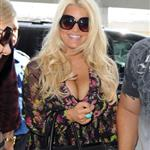 Jessica Simpson and her fiance Eric Johnson walk with their baby through JFK Airport 125843