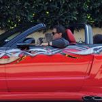 Sylvester Stallone with his daughters in his red Ford Mustang 51154