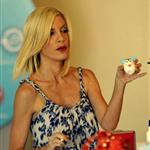 Scary skinny Tori Spelling painting Easter eggs with her husband and their kids  57601